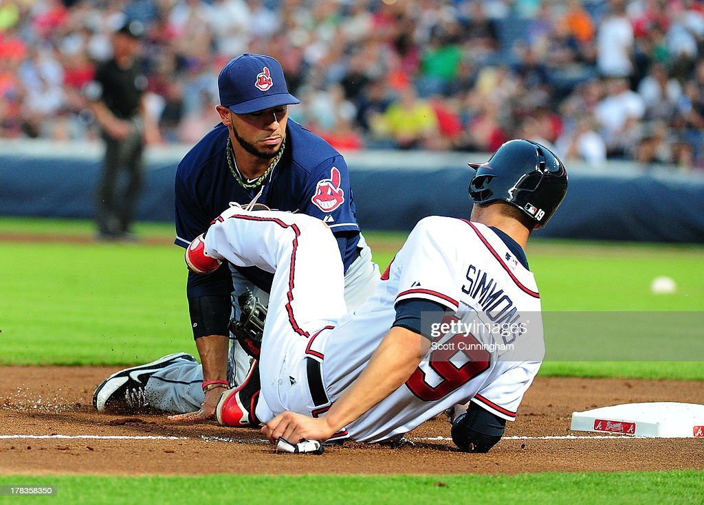 Andrelton Simmons #19 of the Atlanta Braves is tagged out at third base by Mike Aviles #4 of the Cleveland Indians at Turner Field on August 29, 2013 in Atlanta, Georgia.