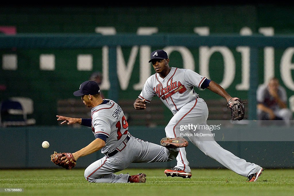<a gi-track='captionPersonalityLinkClicked' href=/galleries/search?phrase=Andrelton+Simmons&family=editorial&specificpeople=8978424 ng-click='$event.stopPropagation()'>Andrelton Simmons</a> #19 of the Atlanta Braves is unable to catch a single hit by Stephen Lombardozzi #1 of the Washington Nationals in the eighth inning during a game at Nationals Park on August 7, 2013 in Washington, DC.