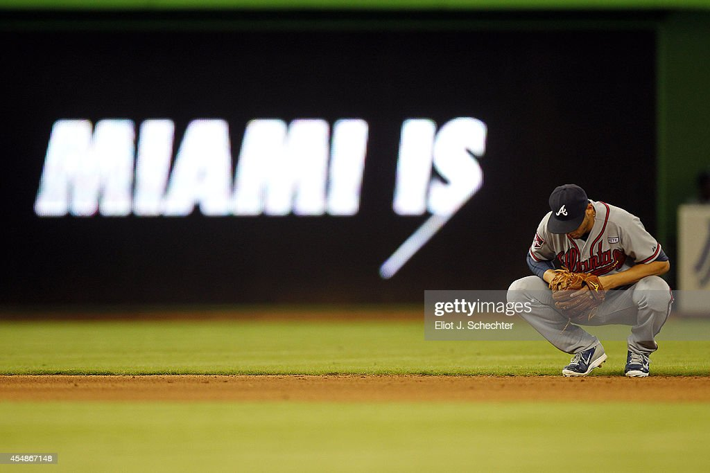 <a gi-track='captionPersonalityLinkClicked' href=/galleries/search?phrase=Andrelton+Simmons&family=editorial&specificpeople=8978424 ng-click='$event.stopPropagation()'>Andrelton Simmons</a> #19 of the Atlanta Braves kneels dejectedly in the outfield during the eighth inning in a 4-0 loss against the Miami Marlins at Marlins Park on September 7, 2014 in Miami, Florida.