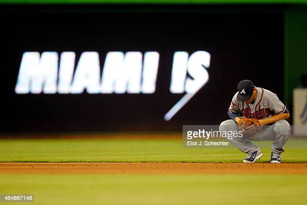 Andrelton Simmons of the Atlanta Braves kneels dejectedly in the outfield during the eighth inning in a 40 loss against the Miami Marlins at Marlins...