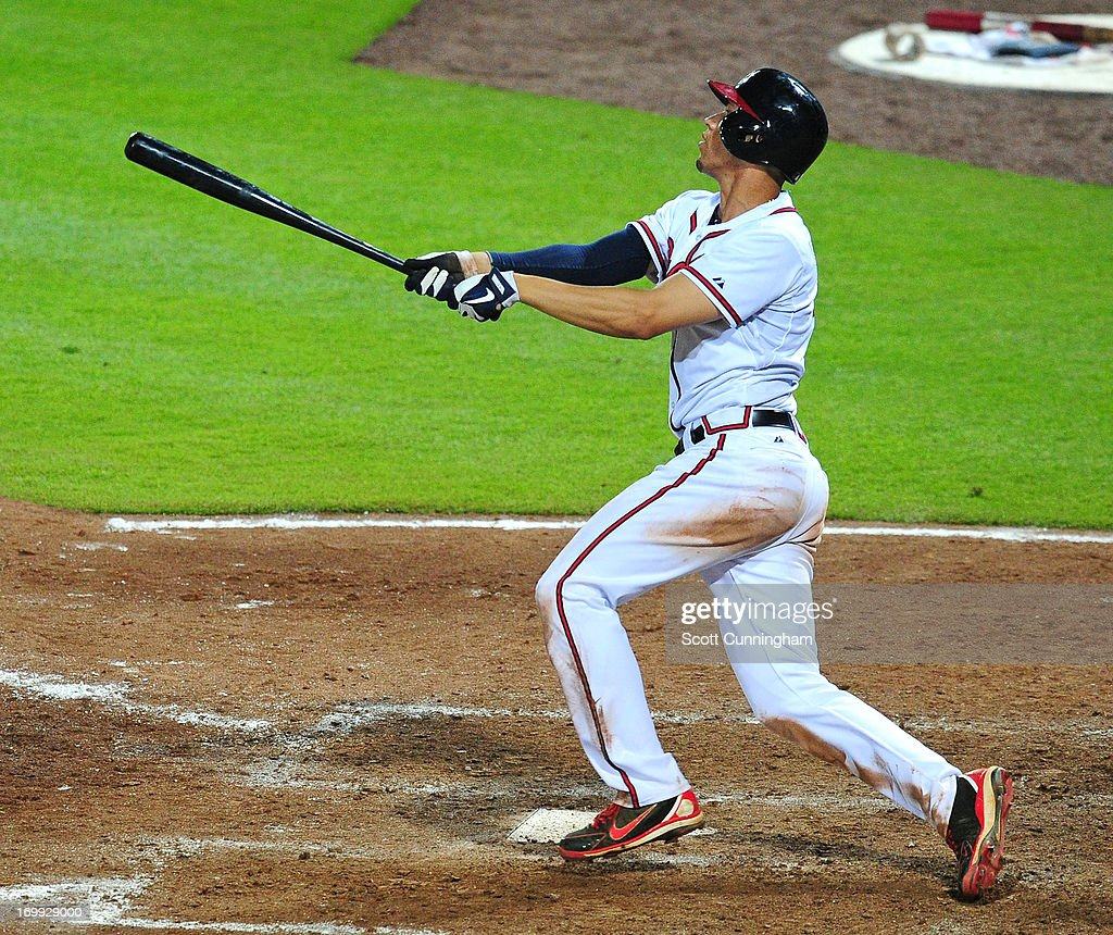 <a gi-track='captionPersonalityLinkClicked' href=/galleries/search?phrase=Andrelton+Simmons&family=editorial&specificpeople=8978424 ng-click='$event.stopPropagation()'>Andrelton Simmons</a> #19 of the Atlanta Braves knocks in the game-winning run in the 10th inning against the Pittsburgh Pirates at Turner Field on June 4, 2013 in Atlanta, Georgia.