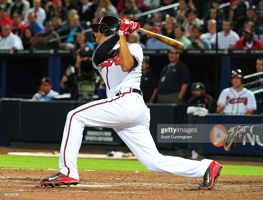 <a gi-track='captionPersonalityLinkClicked' href=/galleries/search?phrase=Andrelton+Simmons&family=editorial&specificpeople=8978424 ng-click='$event.stopPropagation()'>Andrelton Simmons</a> #19 of the Atlanta Braves knocks in the game-winning run in the 9th inning against the Milwaukee Brewers at Turner Field on September 24, 2013 in Atlanta, Georgia.