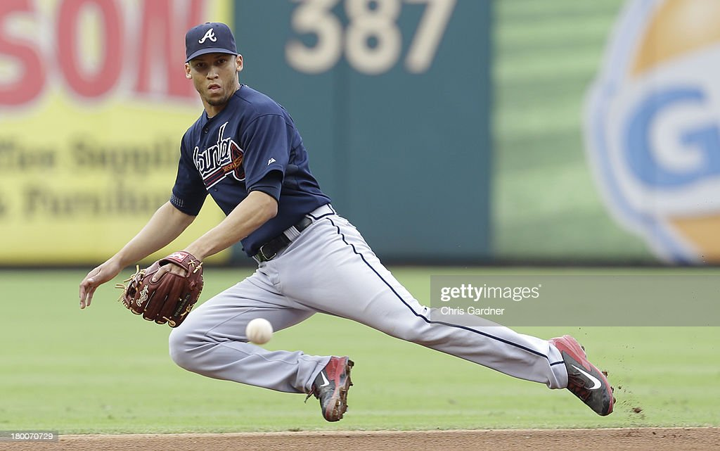 Andrelton Simmons of the Atlanta Braves makes a diving stop on a ball hit by Eric Katz of the Philadelphia Phillies during the fourth inning at...