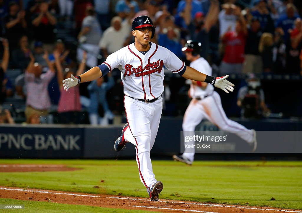<a gi-track='captionPersonalityLinkClicked' href=/galleries/search?phrase=Andrelton+Simmons&family=editorial&specificpeople=8978424 ng-click='$event.stopPropagation()'>Andrelton Simmons</a> #19 of the Atlanta Braves reacts after hitting a walk-off RBI single in the ninth inning against the Toronto Blue Jays at Turner Field on September 15, 2015 in Atlanta, Georgia.