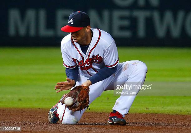 Andrelton Simmons of the Atlanta Braves scoops up a force out hit by Bryce Harper of the Washington Nationals in the eighth inning at Turner Field on...