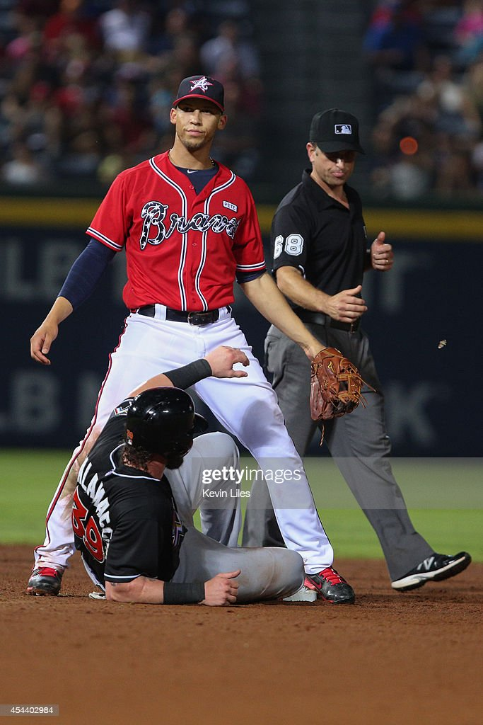 <a gi-track='captionPersonalityLinkClicked' href=/galleries/search?phrase=Andrelton+Simmons&family=editorial&specificpeople=8978424 ng-click='$event.stopPropagation()'>Andrelton Simmons</a> #19 of the Atlanta Braves stands over <a gi-track='captionPersonalityLinkClicked' href=/galleries/search?phrase=Jarrod+Saltalamacchia&family=editorial&specificpeople=836404 ng-click='$event.stopPropagation()'>Jarrod Saltalamacchia</a> #39 of the Miami Marlins after Simmons got Saltalamacchia out the eighth inning at Turner Field on August 30, 2014 in Atlanta, Georgia.