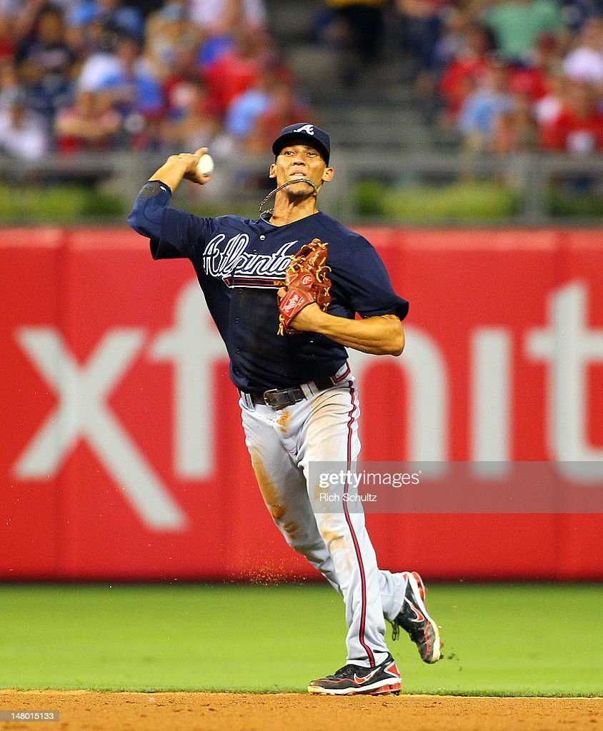Andrelton Simmons #19 of the Atlanta Braves throws to first base to get Chase Utley of the Philadelphia Phillies out during a MLB baseball game on July 7, 2012 at Citizens Bank Park in Philadelphia, Pennsylvania. The Braves defeated the Phillies 6-3.