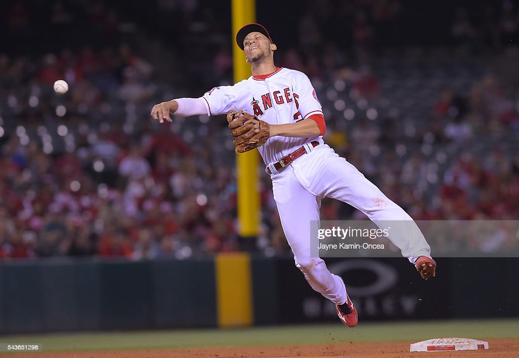 <a gi-track='captionPersonalityLinkClicked' href=/galleries/search?phrase=Andrelton+Simmons&family=editorial&specificpeople=8978424 ng-click='$event.stopPropagation()'>Andrelton Simmons</a> #2 of the Los Angeles Angels makes an out at first base in the seventh inning of the game against the Houston Astros at Angel Stadium of Anaheim on June 27, 2016 in Anaheim, California.