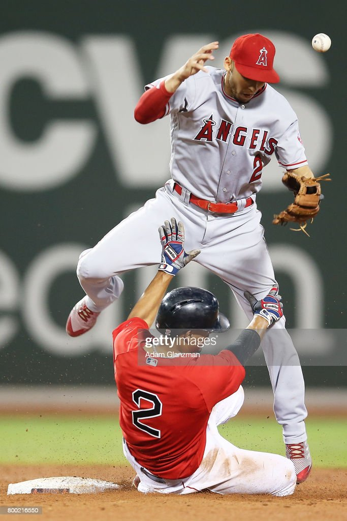 Andrelton Simmons #2 of the Los Angeles Angels of Anaheim bobbles the ball as Xander Bogaerts #2 of the Boston Red Sox slides into second base in the sixth inning of a game at Fenway Park on June 23, 2017 in Boston, Massachusetts.