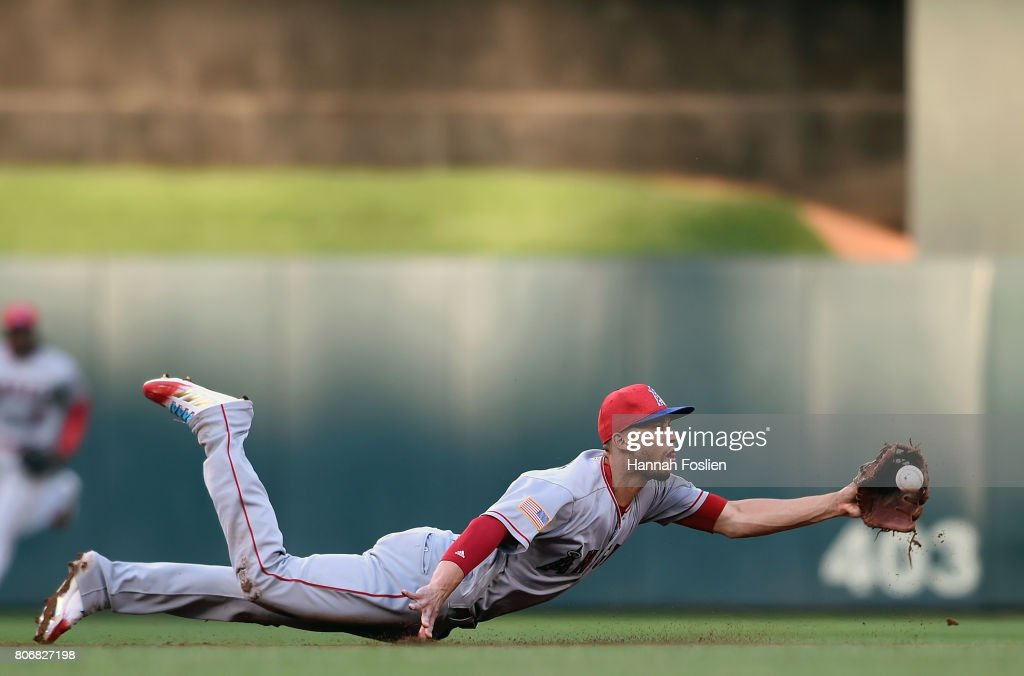 Andrelton Simmons #2 of the Los Angeles Angels of Anaheim flips the ball to second base to get out Jason Castro #21 of the Minnesota Twins during the second inning of the game on July 3, 2017 at Target Field in Minneapolis, Minnesota.