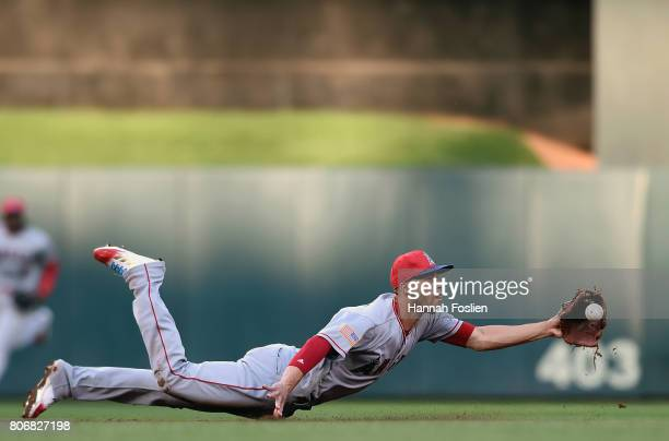 Andrelton Simmons of the Los Angeles Angels of Anaheim flips the ball to second base to get out Jason Castro of the Minnesota Twins during the second...