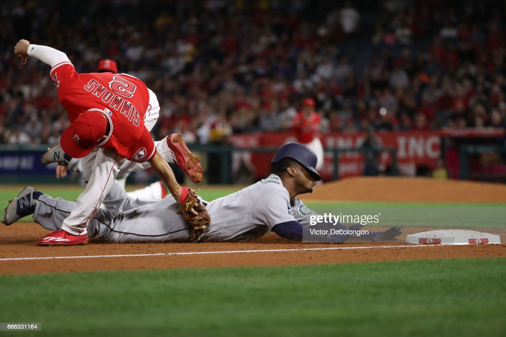 Andrelton Simmons #2 of the Los Angeles Angels of Anaheim gets the tag on Jean Segura #2 of the Seattle Mariners at third base during the third inning of their MLB game at Angel Stadium of Anaheim on April 8, 2017 in Anaheim, California. The original call was safe but was overturned on review of the play.
