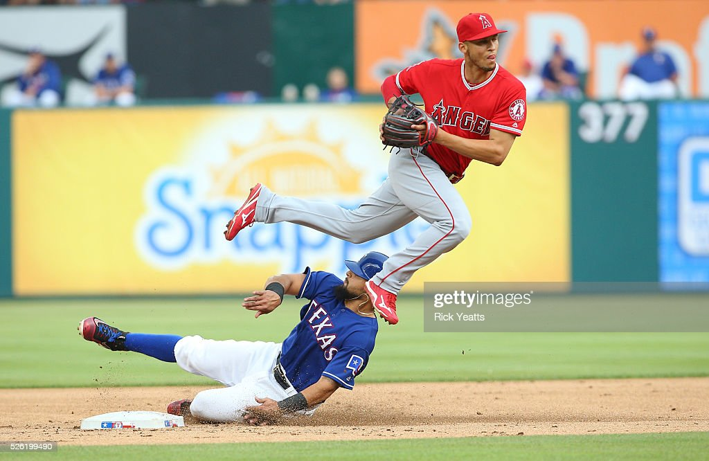 Andrelton Simmons #2 of the Los Angeles Angels of Anaheim makes the out on Rougned Odor #12 of the Texas Rangers at Global Life Park in Arlington on April 29, 2015 in Arlington, Texas.