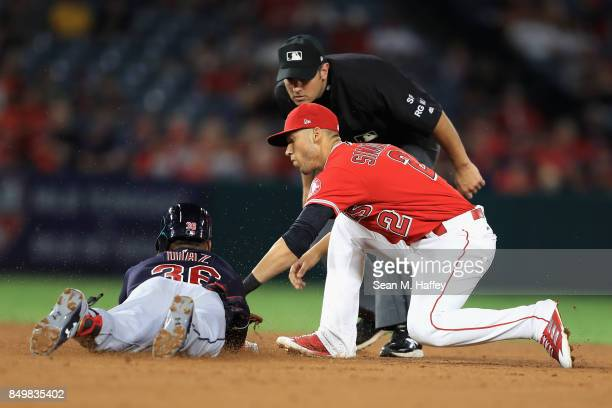 Andrelton Simmons of the Los Angeles Angels of Anaheim tags out Yandy Diaz of the Cleveland Indians at second base stretching an RBI single into a...