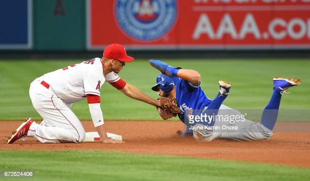 Andrelton Simmons of the Los Angeles Angels tags out Kevin Pillar of the Toronto Blue Jays on an attempted steal in the second inning of the game at...