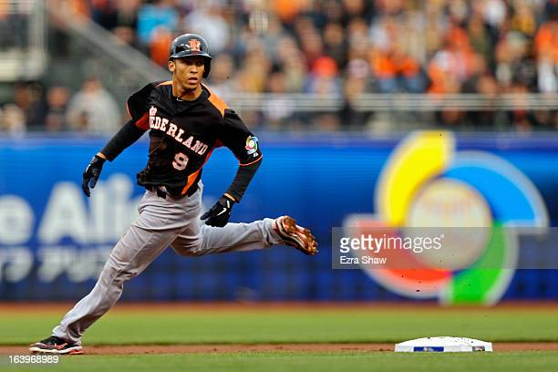 Andrelton Simmons of the Netherlands gets to second base on a wild pitch against the Dominican Republic during the semifinal of the World Baseball...