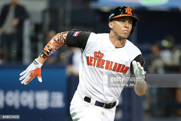 Andrelton Simmons of the Netherlands runs after hitting a RBI double in the second inning during the World Baseball Classic Pool A Game Three between...