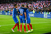 AndrePierre Gignac of France celebrates his goal with Antoine Griezmann and Raphael Varane of France during the international friendly game between...