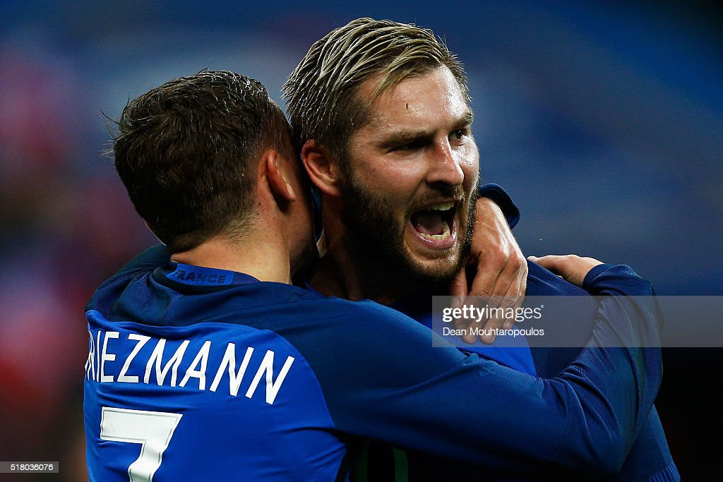 <a gi-track='captionPersonalityLinkClicked' href=/galleries/search?phrase=Andre-Pierre+Gignac&family=editorial&specificpeople=1272457 ng-click='$event.stopPropagation()'>Andre-Pierre Gignac</a> of France celebrates scoring his teams second goal of the game with <a gi-track='captionPersonalityLinkClicked' href=/galleries/search?phrase=Antoine+Griezmann&family=editorial&specificpeople=7197539 ng-click='$event.stopPropagation()'>Antoine Griezmann</a> during the International Friendly match between France and Russia held at Stade de France on March 29, 2016 in Paris, France.