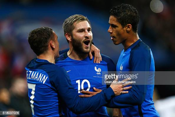 AndrePierre Gignac of France celebrates scoring his teams second goal of the game with Antoine Griezmann and Raphael Varane during the International...