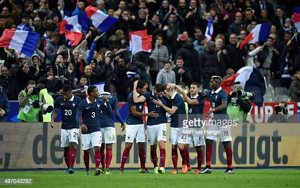 AndrePierre Gignac of France celebrates with his team mates after scoring his side's second goal during the International Friendly match between...