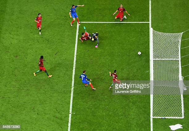 AndrePierre Gignac of France has a shot on goal which hits the post during the UEFA EURO 2016 Final match between Portugal and France at Stade de...