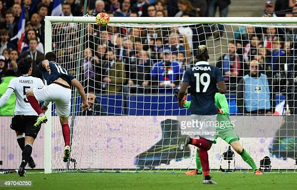 AndrePierre Gignac of France scores his side's second goal during the International Friendly match between France and Germany at the Stade de France...