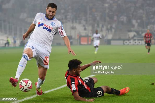 AndrePierre Gignac of Marseille is tackled by Jordan Amavi of Nice during the French Ligue 1 match between Olympique de Marseille and OGC Nice at...