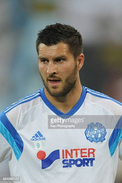 AndrePierre Gignac of Marseille warms up prior to the French Ligue 1 match between Olympique de Marseille and OGC Nice at Stade Velodrome on August...