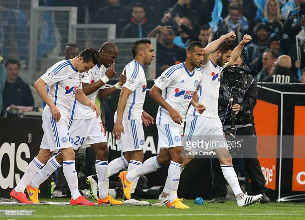 AndrePierre Gignac of OM celebrates scoring the 1st goal for his team with team mates during the French Ligue 1 match between Olympique de Marseille...