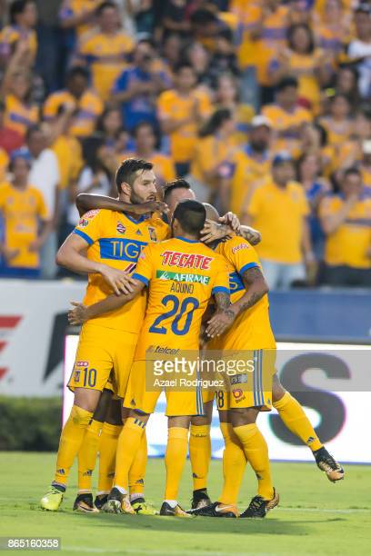 AndrePierre Gignac of Tigres celebrate with teammates after scoring his team's first goal during the 14th round match between Tigres UANL and Toluca...