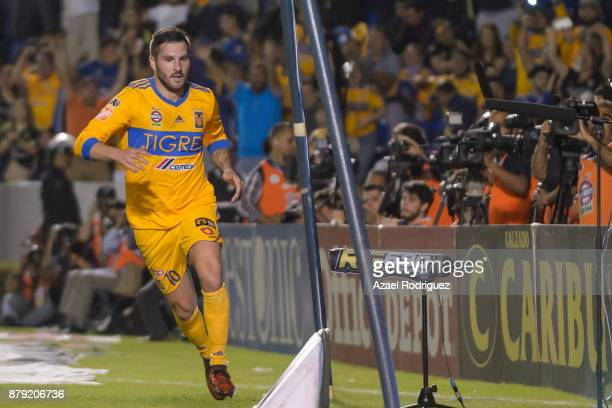 AndrePierre Gignac of Tigres celebrates after scoring his team's first goal during the quarter finals second leg match between Tigres UANL and Leon...