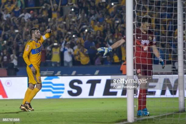 AndrePierre Gignac of Tigres celebrates after scoring his team's third goal during the semifinal second leg match between Tigres UANL and America as...