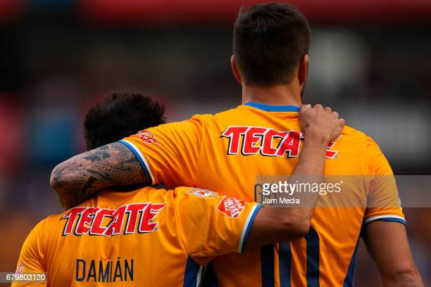 Andrepierre Gignac of Tigres celebrates with teammate Damian Alvarez after scoring the fifth goal of his team during a match between Queretaro...