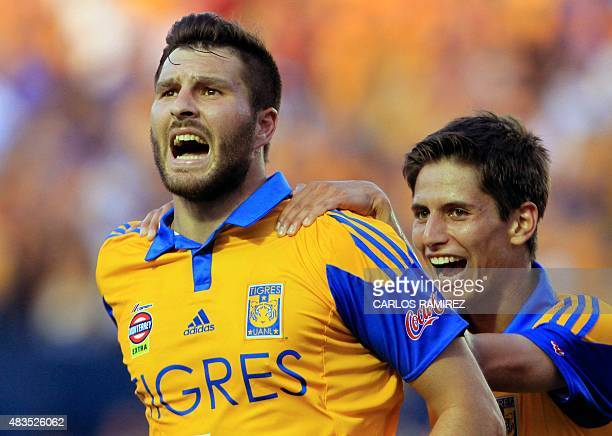 AndrePierre Gignac of Tigres celebrates with teammate Jurgen Damm after scoring against Chivas during their Mexican Apertura football tournament in...