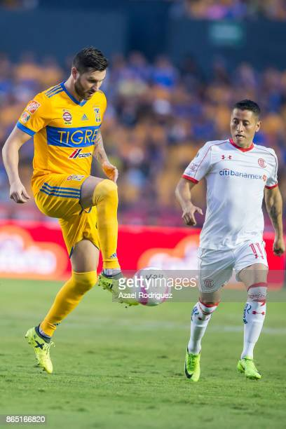 AndrePierre Gignac of Tigres controls the ball while observed by Carlos Esquivel of Toluca during the 14th round match between Tigres UANL and Toluca...