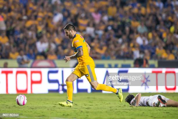 AndrePierre Gignac of Tigres fights for the ball over Santiago Garcia of Toluca during the 14th round match between Tigres UANL and Toluca as part of...