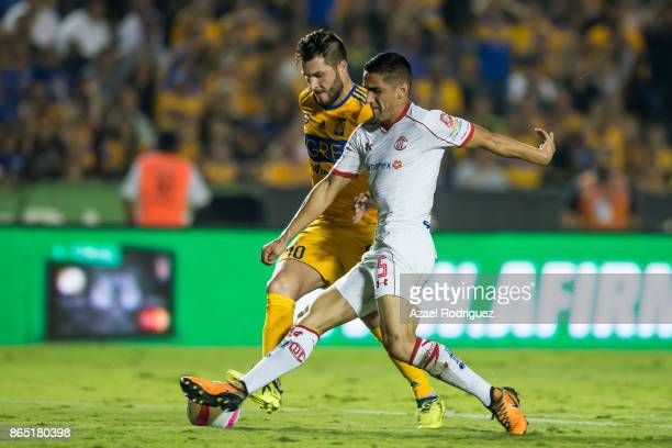 AndrePierre Gignac of Tigres fights for the ball with Osvaldo Gonzalez of Toluca during the 14th round match between Tigres UANL and Toluca as part...