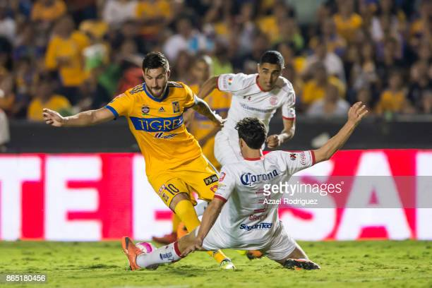 AndrePierre Gignac of Tigres fights for the ball with Santiago Garcia of Toluca during the 14th round match between Tigres UANL and Toluca as part of...