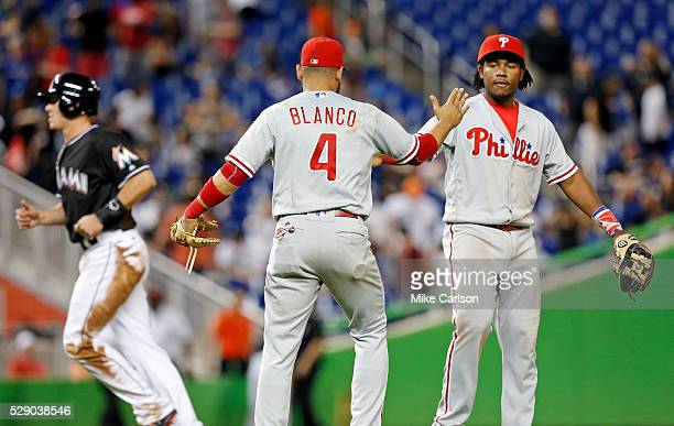 Andres Blanco celebrates with Maikel Franco of the Philadelphia Phillies at the end of the game against the Miami Marlins at Marlins Park on May 7...