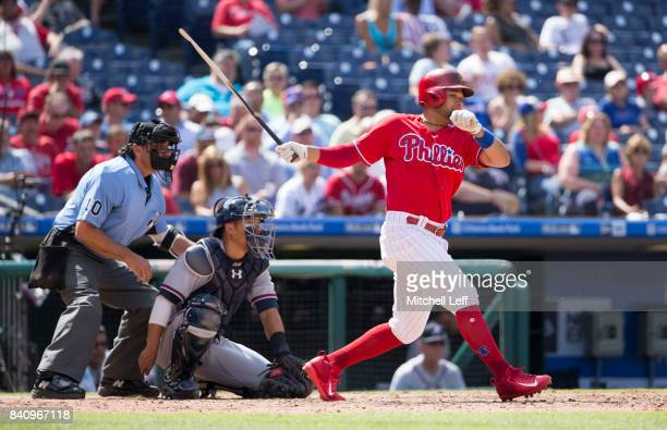 Andres Blanco of the Philadelphia Phillies breaks his bat on a swing in the bottom of the eighth inning against the Atlanta Braves in game one of the...