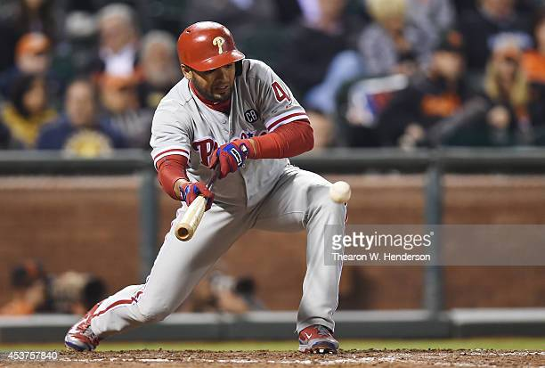 Andres Blanco of the Philadelphia Phillies bunts the ball against the San Francisco Giants in the top of the tenth inning at ATT Park on August 15...