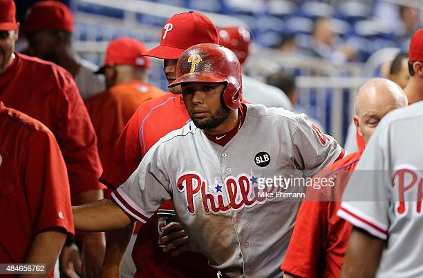 Andres Blanco of the Philadelphia Phillies is congratulated after scoring during a game against the Miami Marlins at Marlins Park on August 20 2015...