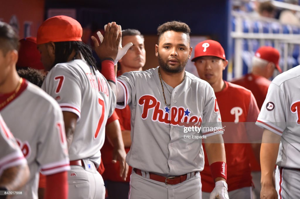 Andres Blanco #4 of the Philadelphia Phillies is congratulated by teammates after scoring in the eighth inning against the Miami Marlins at Marlins Park on September 2, 2017 in Miami, Florida.