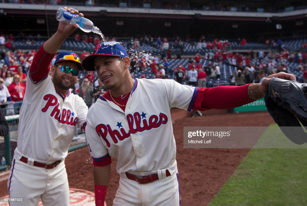 Andres Blanco #4 of the Philadelphia Phillies pours water on Cesar Hernandez #16 after the game against the Atlanta Braves at Citizens Bank Park on April 23, 2017 in Philadelphia, Pennsylvania. The Phillies defeated the Braves 5-2.