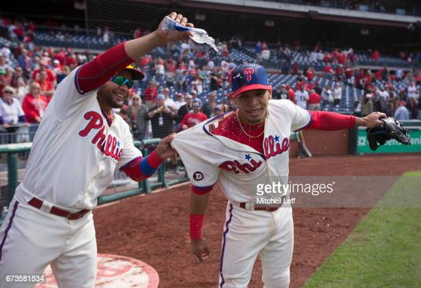 Andres Blanco of the Philadelphia Phillies pours water on Cesar Hernandez after the game against the Atlanta Braves at Citizens Bank Park on April 23...