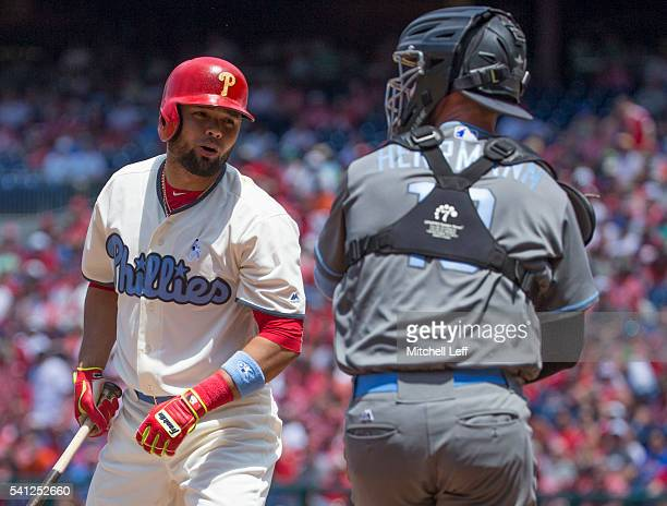 Andres Blanco of the Philadelphia Phillies reacts in front of Chris Herrmann of the Arizona Diamondbacks after striking out in the bottom of the...