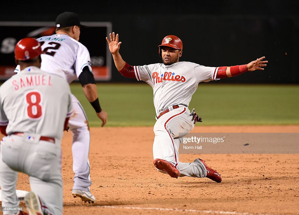 Andres Blanco #4 of the Philadelphia Phillies slides into third base during the ninth inning against the Arizona Diamondbacks at Chase Field on June 28, 2016 in Phoenix, Arizona. Phillies won 4-3.
