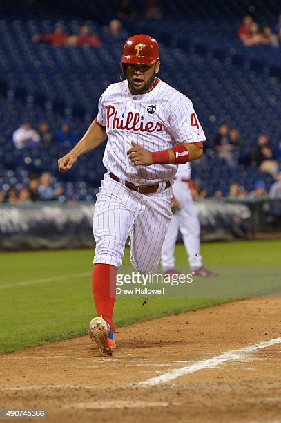 Andres Blanco of the Philadelphia Phillies sores on a wild pitch in the eighth inning against the New York Mets at Citizens Bank Park on September 30...