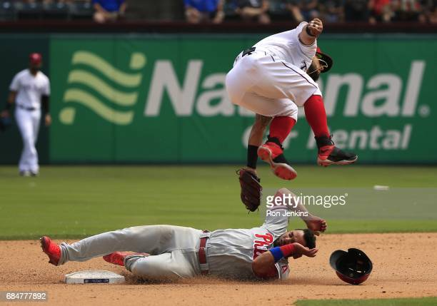 Andres Blanco of the Philadelphia Phillies steals second base as Rougned Odor of the Texas Rangers leaps to avoid a collision during the seventh...